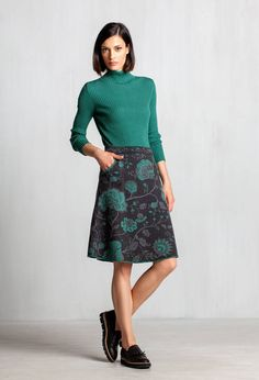 Multicolored jacquard A line skirt featuring an enchanting floral pattern will spice up your winter style with just the right amount of youthful luxury.