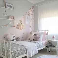 Children's bedroom inspiration. Simple white furnishings and whimsical decor make for a fun room for your little ones