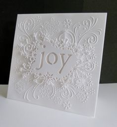 handmade Christmas card ... all white ... embossing folder and die cut ... delightful! ... by sister sandie on Splitcoast Stampers ...