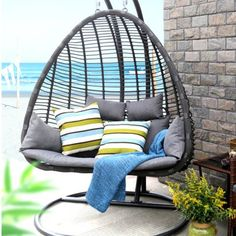 Enjoy Your Yard With This Fun Outdoor Lounge Chair. Built From Thick Brown  Meshed Wicker
