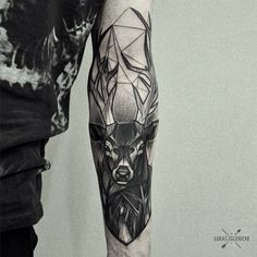 Deer tattoo on the inner forearm inspired in several styles. By Łukas Zglenicki