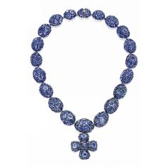 18 KARAT GOLD, SILVER AND SAPPHIRE 'JODY' NECKLACE, MARILYN F. COOPERMAN Formed with bombé clusters set with numerous round and oval-shaped ...