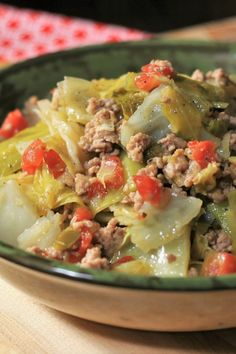 Ms. Angela's Smothered Cabbage     2 TB olive oil     1 onion, chopped     1 green bell pepper, chopped     1 clove garlic, minced     1 pound ground pork     1 TB Creole seasoning      salt to taste     1 head cabbage, cut into 2-inch      1/2 (10 ounce) can diced tomatoes with green chile peppers Yummy Vegetable Recipes, Vegetable Dishes, Side Dish Recipes, Vegetarian Recipes, Healthy Recipes, Cabbage Recipes, Pork Recipes, Cooking Recipes, Smothered Cabbage Recipe