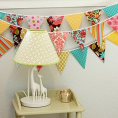 fabric bunting in pink, turquoise, and yellow