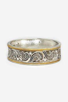 Cast Brass Filigree hinge bracelet. Hand finished with gold and antiquing inset with crystal. Davida Bracelet