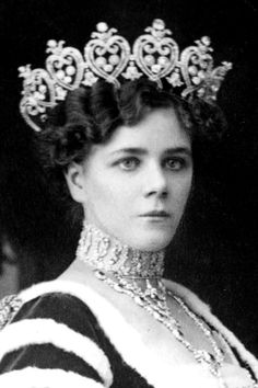The huge belle epouqe diamond tiara, 1903, by Cartier, for the Duchess of Manchester, Helen, nee Zimmerman, an American 'Dollar Princess'. Featuring a series of seven large, heart-shaped double scrolls, twisted at the base, then curling into upright motifs. Within each heart are three circular diamonds, and then topped with a pair of leaves and a larger diamond.