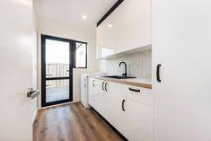 White cupboards with black handles
