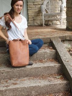 In this Instructable you will learn how to transform a piece of leather into a modern, simple tote bag. It can be used to carry books, as a purse or for groceries or. Diy Leather Tote, Black Leather Tote, Leather Briefcase, Cowhide Leather, Leather Handle, Leather Craft, Leather Handbags, Leather Totes, Leather Bags