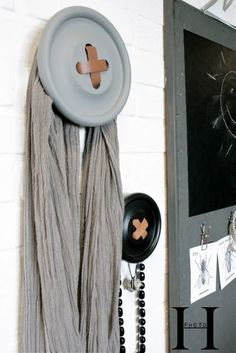 Great idea for decorating a sewing or craft room with upcycled frisbee and leather scraps Craft/sewing room