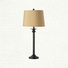 View the Murray Table Lamp from Arhaus. The classic candlestick design of this iron lamp collection adds the finishing touches to any decor.  $149
