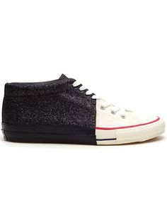 Black cotton canvas boots bonded from half baseball plimsolls and half glitter trainers from Miharayasuhiro. Lace-up. Silver eyelets. Contrasting rubber sole. Defined rubber toe cap. Solid sole