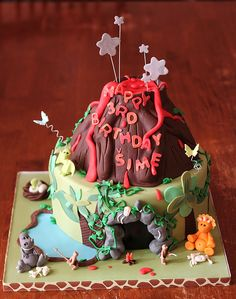 Cute dinosaur and volcano birthday cake