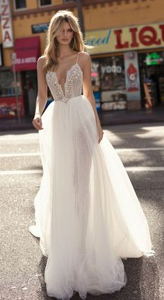 MUSE by Berta wedding dress with spaghetti straps, embellished bodice, and tulle skirt. #musebyberta #weddingdresses #designerweddingdress #weddinginspiration