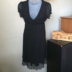 Free People silk dress Floaty and light, this black dress has a ruffle at neckline and a stretchy bodice that closes in front with hook and eye hooks. 100% silk! 31 inches long. Free People Dresses Midi