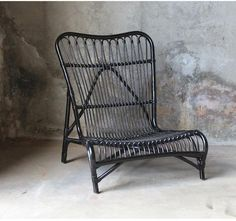Muubs' Bagao Lounge Chair in black rattan