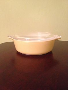 Vintage Yellow Pyrex 1 Pint Casserole. The bottom is marked Pyrex Trade Mark Ovenware 1 PT. 471 Made in U.S.A. This is a great small casserole for a side dish or individual meal. The lid has a chip on the handle and a few minor scratches. The bottom has a stain on the side right by