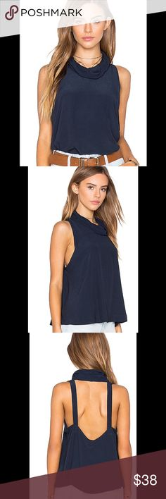 """Free People City Lights blue cowl top XS New with tags Free People City Lights cowl-neck cut out top Size XS In Blue An open back adds an unexpected twist of modern cool to this effortlessly polished cowl-neck top from Free People. Wear it layered for a classic look or flaunt its fashion-forward design with your favorite jeans. Fits large, order one size down Cut for a loose fit Cowl neck, sleeveless, cutout back, pullover style Approx. 19"""" from back neck to hem, based on a size extra-small…"""