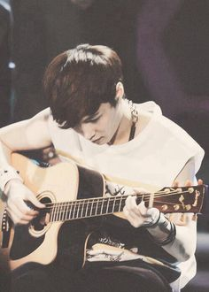 EXO-Lay...and a guitar...I wish I could hear him:)