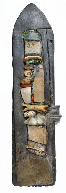 """Mixed Blessings,"" by Helen Nock (U.K.), slate, glass and found objects, including beach glass, ceramic shards, pottery, bone, stone and fossil."
