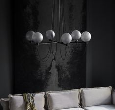 The iconic Studio Lamp series, designed by Laura Bilde, and the Globe Light series, designed by Emil Thorup, are part of the permanent lighting. Globe Chandelier, Black Chandelier, Danish Furniture, Furniture Design, Design Scandinavian, Studio Lamp, Black And White Interior, Grey Glass, Globe Lights