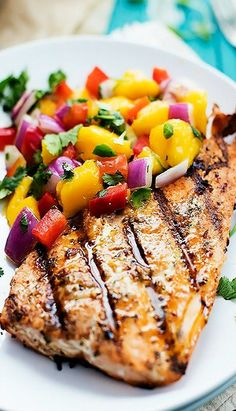Filleted the fish Yesterday.Grilled Salmon with Mango Salsa - 32 dinners tonight. Filleted the fish Yesterday.Grilled Salmon with Mango Salsa 32 dinners tonight. Filleted the fish Yesterday.Grilled Salmon with Mango Salsa Seafood Dishes, Seafood Recipes, New Recipes, Favorite Recipes, Summer Recipes, Salmon With Mango Salsa, Pineapple Salmon, Honey Salmon, Gastronomia