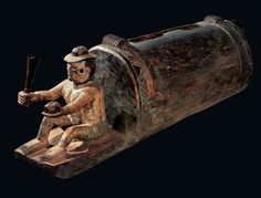 FigureSeated Male Figure. Mbembe peoples; Ewayon̆ River region, Cross River Province, Nigeria, 19th century. Wood, L. 86⅝ in. (220 cm) - READ article