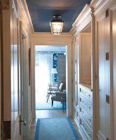 Built-in storage, beautiful millwork & moldings, dark blue ceiling, semi-flush lantern