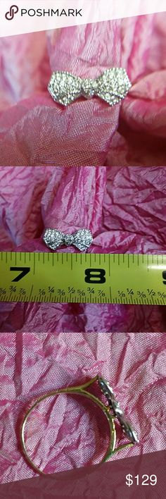 14k two tone diamond bow ring 7.5 Solid 14k ring. Bow is white gold with diamonds  (too small to confirm if genuine) and ring is yellow gold.   Very nice size bow! Stamped 14k. Ring is size 7.5  Weighs approximately 2 grams   Offers welcome,  no low balls! No trades Jewelry Rings
