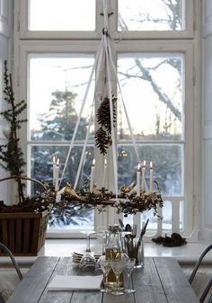 candle wreath above the table . .. . via: This Ivy House