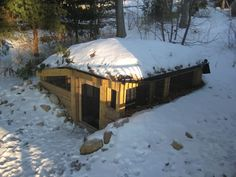 We're totally building one of these. Cheap to build, easy to heat underground chicken coop. Would also keep them safe from predators