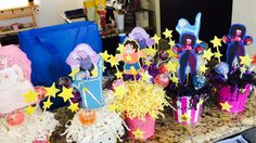 Steven universe party decor  What you need:  Small $1 color buckets Colored shredded paper Foam sheets Print out of character Wooden sticks Lollipops  Hot glue gun Scissors