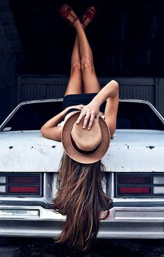 yes, my hair always happens to look this good when i'm lounging on the trunk of an old car.