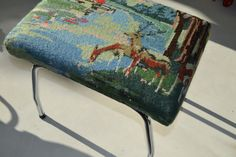Vintage cross stitch upcycled into a new stool.