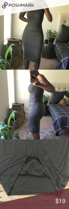 """Stem Striped Rouched Dress Gently used midi style dress. Olive green with black stripes in color. Ruched sides and tons of stretch. Small mark (as indicated in last photo) on bottom of dress. Measurements are 43"""" long, 17"""" bust, 16"""" waist and hips, 10"""" arm opening. Stem Dresses Midi"""