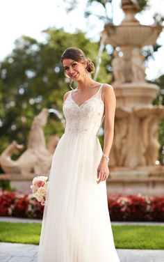 Find your dream dress with Stella York wedding dresses featuring a beaded shear Tulle overdress. The sweetheart bodice highlights hand-sewn Diamantes on the bust and sexy Satin spaghetti shoulder straps.