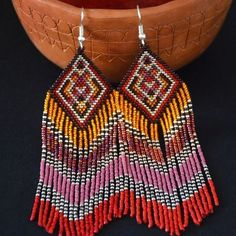 One of my favourite pair of earrings.. they make me feel shining and powerful like autumn colours Available on my etsy shop, link in bio! #behandson #seedbeads #seedbeadearrings #gypsyearrings #gypsystyle #gypsyearrings #bohostyle #bohochic #bohoearrings #beadwork #beading #beadedjewelry #nativeamericanart #nativeamericanjewelry #sunnyday #blueearrings #etsysellersofinstagram #etsyshop #etsyseller #beadedearrings #tribal #earrings #jewelry#handmadejewellery #handmadeearrings #handmadewit
