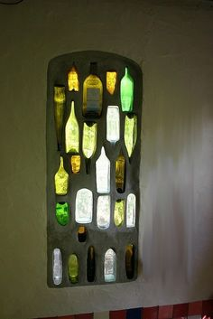 That is so cool! A wine bottle stained glass window. Will have to ask the glass people in my life about this-wonder if you could just make a panel to stand in the yard to catch the sun's rays?