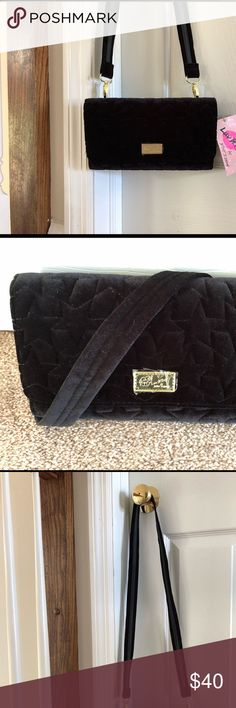 """Betsy Johnson Amanda Black Velvet Star Crossbody Brand new with tags Luv by Betsey Johnson black velvet crossbody purse with quilted stitched stars! Tri-fold envelope clutch with a magnetic closure. Really cute striped lining and gold toned hardware! Length: 9"""", Height: 5.5"""" Betsey Johnson Bags Crossbody Bags"""