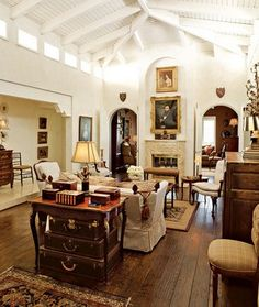 What's not to love here - high ceiling w/exposed trusses, double arched openings, oak plank flooring