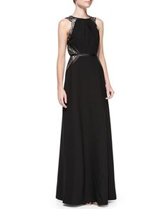 """Stretch crepe and chantilly lace """"Genevieve"""" gown by Shoshanna with faux leather (cotton/polyurethane/spandex) trim. Round neckline.  Sleeveless with cut-in shoulders. A-line silhouette; banded waist. Hidden back zip. Polyester/spandex self; nylon lace. Dry clean."""