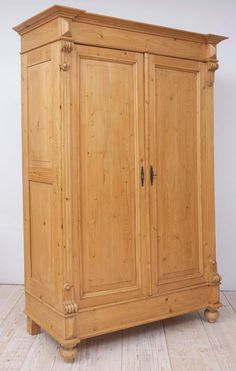 A pine armoire with two raised-paneled doors, carved escutcheons defining the corners, side panels and resting on turned bun feet. Dating from the rise of the German Republic (Gründerzeit period). Home Furniture, Furniture Design, Furniture Storage, Armoire For Sale, French Chairs, Modern Wardrobe, French Country House, Storage Cabinets, Amor