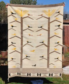 This is a wonderful old pictorial Navajo rug. It has been beautifully woven of soft wools in a very attractive combination of colors. There are 28 birds in combinations of bright yellow black and soft brown. Navajo Weaving, Navajo Rugs, Corn Plant, Bird Feathers, Needlepoint, Carpets, Native American, Textiles, Birds