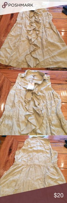 NWT Souvenir Vest NWT cream colored vest. Frilly middle and zips. 31 in from shoulder to bottom. Thin and lightweight souvenir Tops