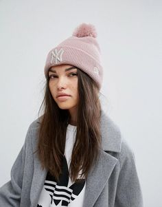 b4536b18f47 Shop New Era Pink Beanie with Pom at ASOS.
