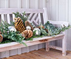 Holiday Bench Decor Give a bench some holiday spirit with an arrangement of holiday greenery, pinecones, gazing balls, and ornaments. Spray the arrangement with a light dusting of fake snow for extra winter flair. Christmas Greenery, Noel Christmas, Christmas Lights, Christmas Crafts, Country Christmas, Christmas Porch Ideas, Christmas Ornaments, Christmas Entryway, Christmas Garden