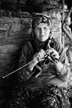 old Turkish woman knitting in market.
