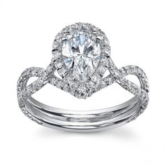 Beautiful engagement ring setting with a pear shaped center stone   Emma Parker