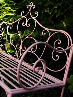 How lovely - mauve wrought iron garden bench