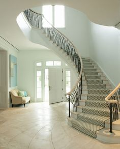 limestone floors with a nautilus design. LOVE it. the wrought-iron railings are meant to imitate marsh grass.