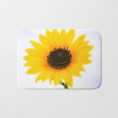 The perfect Bath Mats: fuzzy, foamy and finely enhanced with brilliant art. Featuring a soft, quick-dry microfiber surface, memory foam cushion and skid-proof backing. Time to lose that ratty shower rug and update your bathroom.      - Available in two sizes   - Soft, fuzzy microfiber surface    - Memory foam cushioning   - Skid-proof backing   #sunflower #flower #art #decor #photography #accessories #rug #bath #bathroom #mat #bathmat #accessories